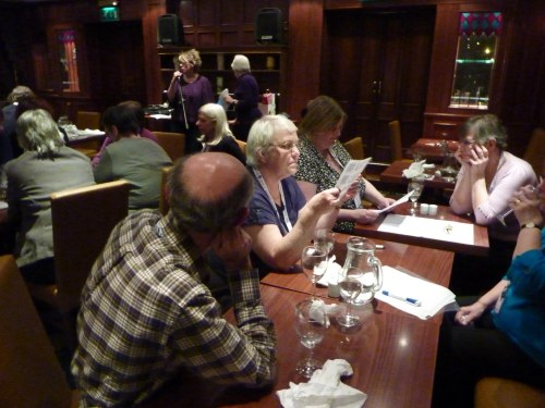 The Pewterers ponder a difficult question at the Quiz