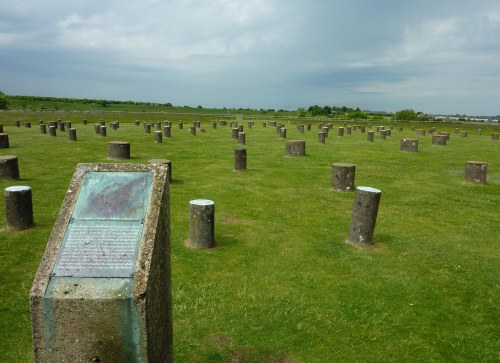 Woodhenge. The edge of Durrington Walls can be seen on the horizon.